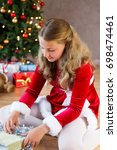 girl with santa dresses and... | Shutterstock . vector #698474461