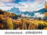 foggy autumn view of parrocchia ... | Shutterstock . vector #698480494