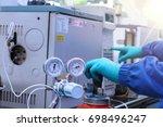 hand work and start gas... | Shutterstock . vector #698496247