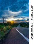 the road down hill during sunset   Shutterstock . vector #698521684