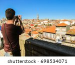 male tourist taking a picture... | Shutterstock . vector #698534071