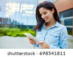 girl with a tablet outdoor   Shutterstock . vector #698541811