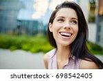 girl laughs | Shutterstock . vector #698542405