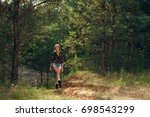 pretty tourist girl walking in... | Shutterstock . vector #698543299