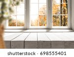white table on the background... | Shutterstock . vector #698555401