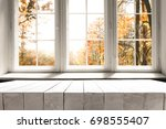 white table on the background... | Shutterstock . vector #698555407