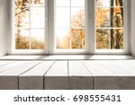 white table on the background... | Shutterstock . vector #698555431