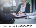 business team working on... | Shutterstock . vector #698563795