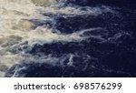 foam on the blue sea   Shutterstock . vector #698576299