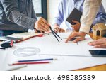 consultation between colleagues ... | Shutterstock . vector #698585389