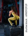 muscular woman doing jumping... | Shutterstock . vector #698592919