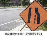 Small photo of Lane ends merge sign for construction purposes