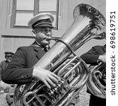 Small photo of Musician playing tuba in street