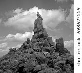 Small photo of Eagle statue on top of heap of stones