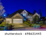 luxury house at night in... | Shutterstock . vector #698631445