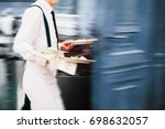 waiter serving in motion on... | Shutterstock . vector #698632057
