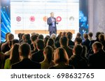 audience listens to the... | Shutterstock . vector #698632765