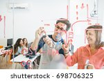 young man drawing draft on... | Shutterstock . vector #698706325