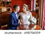 walk the newlyweds. the bride... | Shutterstock . vector #698706559