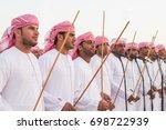 men perform a yawalah... | Shutterstock . vector #698722939