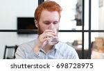portrait of man drinking water | Shutterstock . vector #698728975