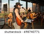 musician playing guitar at a...