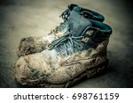 Small photo of work boots mud muddy play gradient photo photograph image detailed laced laces lace dried dirt dirty concrete sidewalk vivid macro closeup