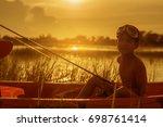 Silhouette Of Boy Catch Fish...