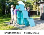 friends making pyramid with... | Shutterstock . vector #698829019