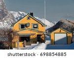 Yellow Cottages Snowy Reine...