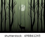 deer in the dark misty forest... | Shutterstock .eps vector #698861245