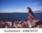 beautiful girl traveler in...   Shutterstock . vector #698876929