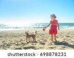 little blond girl in red dress... | Shutterstock . vector #698878231