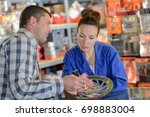 man buys brake wheel in auto...   Shutterstock . vector #698883004