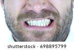 angry man grinding teeth  close ...