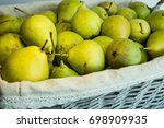 green pears in a wicker basket | Shutterstock . vector #698909935