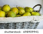green pears in a wicker basket | Shutterstock . vector #698909941