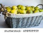 green pears in a wicker basket | Shutterstock . vector #698909959