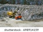 huge excavator  truck and man...