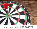 red dart arrow and hitting in... | Shutterstock . vector #698944399