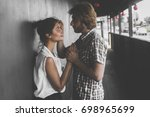 couple in city  man and woman... | Shutterstock . vector #698965699