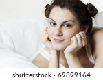 young smiling woman lying in bed | Shutterstock . vector #69899164