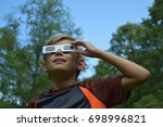 boy child wearing solar eclipse ... | Shutterstock . vector #698996821
