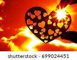 silhouette of heart shape in... | Shutterstock . vector #699024451