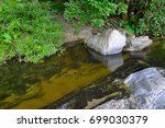 waterfalls on the mountain  the ... | Shutterstock . vector #699030379