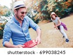 young smiling couple playing... | Shutterstock . vector #699038245