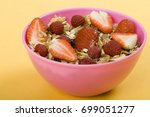 cereal with fresh strawberries | Shutterstock . vector #699051277
