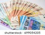 euro cash. many euro banknotes... | Shutterstock . vector #699054205
