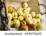 fresh harvest of apples in a... | Shutterstock . vector #699073645