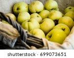 fresh harvest of apples in a... | Shutterstock . vector #699073651